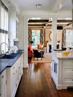 """Soapstone countertop, blue ceiling, wood floor, view into wood ceiling in family room, interior design by David Netto.  This is a Gil Schafer restoration of """"Boxwood"""", a 1914 Nashville home, as seen in Veranda."""