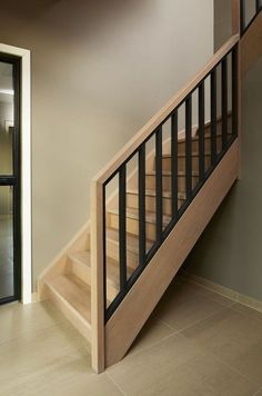 Oak staircase with wooden balusters in beech blackened Modern Staircase balusters Beech blackened oak Staircase Wooden Tiled Staircase, Staircase Handrail, Staircase Remodel, Staircase Makeover, Wooden Staircases, Bannister, Interior Stair Railing, Stair Railing Design, Modern Stairs