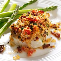 Bacon & Tomato-Topped Haddock Recipe -Bacon presents a compelling argument for anyone who doesn't like fish. And for those who do, it just got better. —Sherri Melotik, Oak Creek, Wisconsin