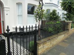 Black Limestone which blends really nicely with the black and white Victorian tiled pathway