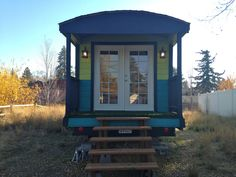 This 180-square-foot gypsy wagon style trailer house makes great use of space on a single level. Sure, ithas one of the smaller kitchen areas we've seen in a tiny house of its size, but it makes up for that with a relatively spacious modern bathroom and a bed that you don't have to climb a ladder to get to. The colorful exterior, wide porch, ...