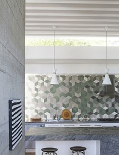 """When designing the layout of the tiles for the kitchen splashback, John wanted the result to be """"chaotic and adventurous""""."""