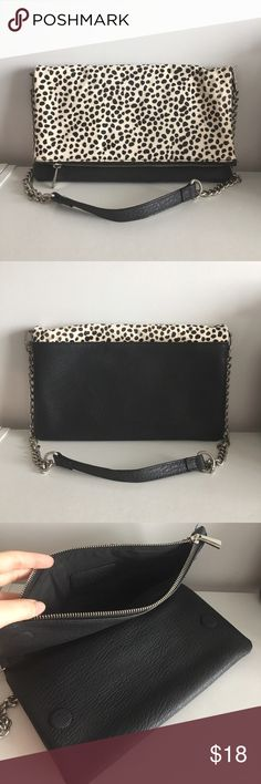 """Express Clutch with Shoulder Strap - Express spotted handbag - Upper portion is constructed in a spotted pony hair, rest of body is made in a textured faux leather - Spotted portion folds over and magnetically clasps to bottom portion and can be opened with zipper - Removable chain for versatility when wearing - Spotted portion is only area showing wear with minor stains, see photos  - Measures 11 1/2"""" x 7 1/2"""" when closed and 11 1/2"""" x 13 1/2"""" when unfolded Express Bags Clutches & Wristlets"""