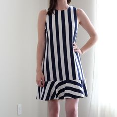 ASOS striped dress 8 Adorable navy and white striped dress by asos. Brand new never worn. Size 8 and fits true to size (M). Sleeveless style with a V neck in the back. ASOS Dresses Mini
