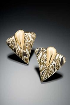 Cool earrings by artist James Binnion, featuring his signature mokune gane