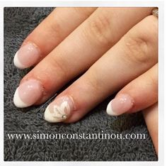 A fresh flower for Spring!  We think this look is so pretty. French manicure acrylic extensions with hand painted nail art on selected nails  Monika has a range of nail services see our pricelist for the full list of services: http://ift.tt/2nvFlXW To book or enquire call 02920461191 O.Constantinou & Sons. 99 Crwys Rd Cardiff. CF24 4NF #simonconstantinou #beautysaloncardiff #nailart #manicure #frenchmanicure #nailextensions #flowers #spring #opi @opinailsuk @opi_professionals