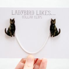 Handmade black cat collar clips. http://www.justdaydreaming.com/product-category/crazy-for-cats/
