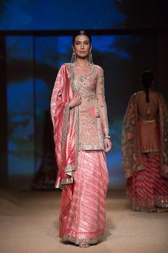 Ashima Leena pink sari lehnga. More here: http://www.indianweddingsite.com/bmw-india-bridal-fashion-week-ibfw-2014-ashima-leena/