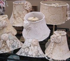 I love the vintage lace on the lampshades...