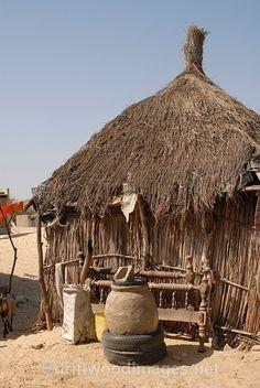 Hut exterior in Fulani village.  Fulani Village, SENEGAL