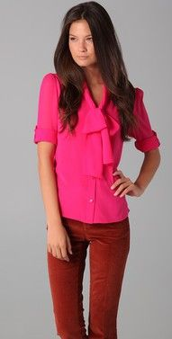 Pink blouse ( w/ black pencil skirt or pant suit)