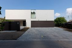 Garage doors seamlessly disappear into a greater plane - looks crisp and tidy.