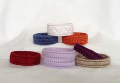 DIY 7 Big Bold Bracelets Plastic Canvas by BarrettDesignStudio (Etsy) -- Just think of all of the ways that you could customize colors of yarn to make your Little Miss DressUp a collection of these!