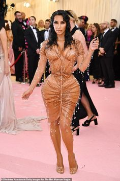 Savage: Piers poked fun at Kim Kardashian's revealing caramel corset dress, which he compared to a pair of Spanx