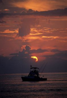 """Wild Bill"" fishing boat on the water at sunset (1989). 
