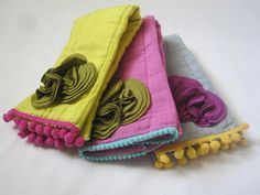NEW, The Fancy Burpie Trio, Infant Burpcloth, Embellished, Hand Dyed Cloth Diaper, Girl, Knit Flower Buds, Pom Trim, Mustard, Raspberry. $34.00, via Etsy.