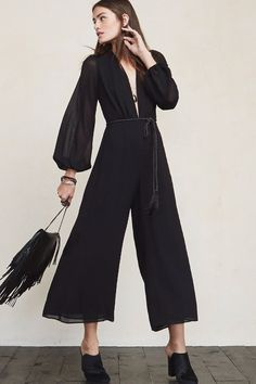 In case you haven't noticed, we're pretty into plunging necklines around here. The Darla Jumpsuit is yet another ultra flattering thing that let's you show off a bit without feeling overexposed. This is a georgette jumpsuit with a deep V neckline, sheer puffed long sleeves and a hook/zip closure in the back. https://www.thereformation.com/products/darla-jumpsuit-black?utm_source=pinterest&utm_medium=organic&utm_campaign=PinterestOwnedPins