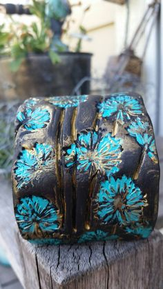 Check out this item in my Etsy shop https://www.etsy.com/listing/246776176/dandelion-polymer-clay-cuffbracelet-aqua