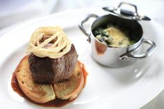 Tournedos Rossini (circa 1833): tender beef, foie gras, black truffles with Madeira sauce, and creamed spinach.