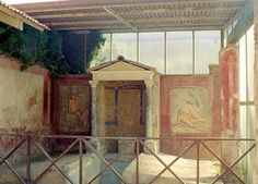 House of Octavius Quartio, Pompeii. Biclinium: Dining room with two couches and a water feature between
