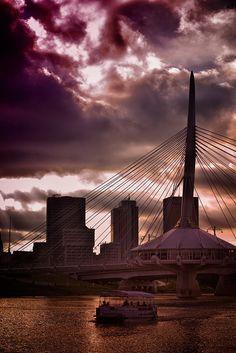 Boat passing The Forks Bridge at dusk (Winnipeg, MB) by AJ Batac, via Flickr