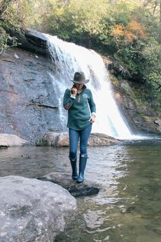 Cozy outdoor style with hunter boots, wool hat, quilted monogrammed pullover. Exploring western North Carolina waterfalls. Blogger pose. #hunterboots #hunter #monogrammed #waterfalls from @peachfullychic