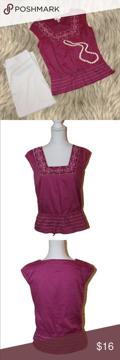 """Adorable Embroidered Loft Top The detailing on this top makes it so pretty and feminine! About it:  * Color is a shade of violet  * Neck and waist have embroidery  * Side zip * Fully lined * Cap sleeves * Loose elastic on the waist/hips with tie * A tad of stretch * Shell and lining are 100% polyester   MEASUREMENTS:  * Armpit to pit 18"""" * Waist 32"""" plus elastic * Hips 38"""" * Length from back of neck 22.5""""  This top is in excellent condition. There are no flaws. It is size 4 and by Loft. If…"""