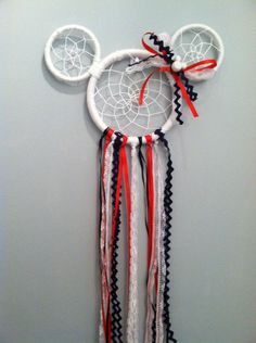 A personal favorite from my Etsy shop https://www.etsy.com/listing/228325027/mickey-mouse-minnie-mouse-dream-catcher