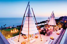 An all-white Gypset event in Malibu with custom rugs, lights, scultpures and seating.