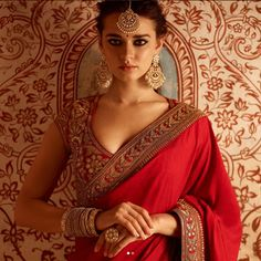 Thinking of having designer sarees for your wedding? Think about the blouses as well. Here are a few of the best blouse designs for designer sarees from the collections of one of the most celebrated Indian Fashion designer Sabyasachi. Blouse Back Neck Designs, Bridal Blouse Designs, Saree Blouse Designs, Choli Designs, Sabyasachi Sarees, Lehenga Choli, Anarkali, Red Lehenga, Sari Bluse