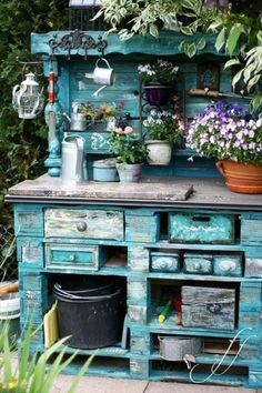 Absolutely amazing potting bench / dresser for the garden. Made from pallets and upcycled drawers - all with an amazing rustic style turquoise paint job. Stunning!