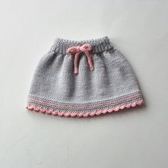 Bebek elbise modelleri Informations About Baby skirt knitted baby skirt merino wool skirt grey and pink skirt MADE TO ORDER … Knitting For Kids, Baby Knitting Patterns, Baby Patterns, Hand Knitting, Vogue Knitting, Baby Girl Skirts, Baby Skirt, Pull Bebe, Knit Baby Dress