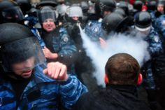 UNREST: A police officer sprayed demonstrators with pepper spray during a protest against the government's decision to suspend a European Un...
