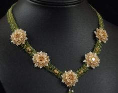 In Bloom is a beautiful floral necklace easily customizable by choosing your own color scheme. Individually beaded flowers begin with a sparkling Beading Tutorials, Beading Patterns, Jewelry Show, Jewelry Making, Jewelry Ideas, Necklace Tutorial, Floral Necklace, Pearl Necklace, Beaded Flowers