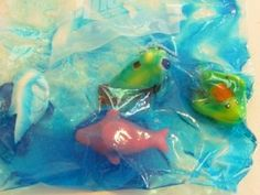 Sensory bags for Pre-K: Hair gel, food coloring, and theme-related small toys.