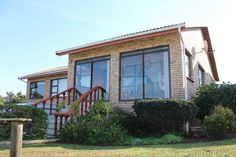 Low maintenance facebrick home alongside the Royal Port Alfred Golf Course. This home enjoys a lovely sea view and is comprised of four bedrooms and two. Maine House, Property For Sale, Beautiful Homes, Home And Family, Real Estate, Sea, Street, Outdoor Decor, House Of Beauty
