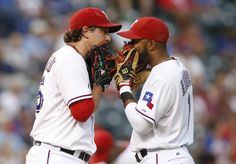 CrowdCam Hot Shot: Texas Rangers starting pitcher Derek Holland talks with shortstop Elvis Andrus on the mound in the first inning of the game against the Oakland Athletics at Rangers Ballpark in Arlington. Photo by Tim Heitman
