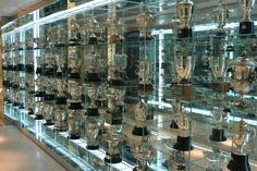 This is just the start of the Real Madrid football (soccer) team's trophy room at Santiago Bernabeu Stadium in Madrid, Spain. Real Madrid Football, Trophy Rooms, Awards, Photo Wall, New Homes, Adidas, Album, Frame, Home Decor