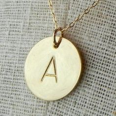 Gold Initial Necklace -  DOT Simple Hand Stamped Necklace by E. Ria Designs. $37.00, via Etsy.
