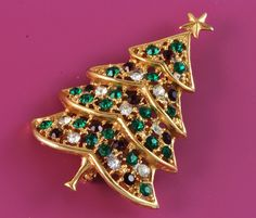 """Christmas Tree Vintage AB Crystal Rhinestone Pin  $20.00  Vintage Christmas Tree Pin  Red and Green AB Crystals  Set in Goldtone  Unsigned  Condition: Excellent  2 1/4"""" long x 1 1/2"""" at the widest"""