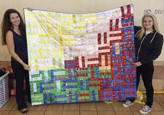 Lindsey and I holding up the quilt that I made using all of Lindsey's swimming ribbons.  Lindsey formerly swam for Lake Stevens Swim Club (PNS) and is now an Age Group Coach for Gold's Aquatics Club (PNS).  I am a parent to three children on Gold's and also a USA Swimming Official Starter.  I love my kids' coaches!