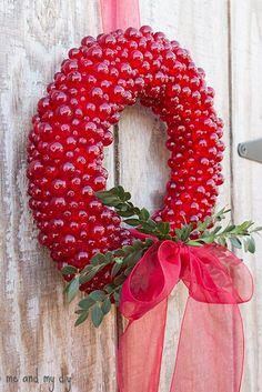 Clear red beads on a styrofoam wreath form. The beads are stuck in the wreath with pins with heads painted with red nail polish (from Martha Stewart). by cassandra