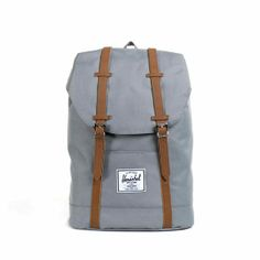 Herschel keeps you equipped and looking sharp for back to school with the  mid-volume Retreat Grey canvas backpack. This compact book bag takes a no  nonsense ... e7fa2c76932ec