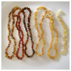 Genuine amber teething necklace. Baltic amber contains succinic acid which has natural analgesic and anti-inflammatory properties. It has been used for centuries to take the edge off teething pain in babies as well as other aches and pains in adults.