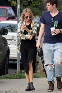 Emma Roberts wearing Ray-Ban Rb3517 Foldable Round Sunglasses, Anine Bing Olive Plaid Shirt, Anine Bing Boots with Silver Studs and Elkin Play Dress