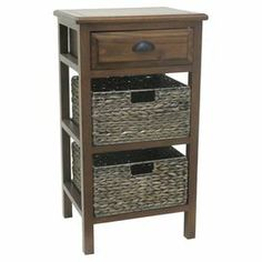 "Add a classic touch to your living room or home library with this essential side table, showcasing 2 storage baskets and 1 drawer.   Product: Side tableConstruction Material: WoodColor: BrownFeatures: Two baskets includedDimensions: 36"" H x 20"" W x 17.5"" D"