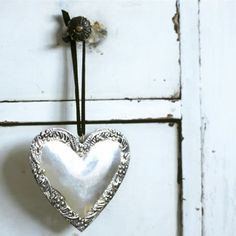 silver heart hanging from dresser knob