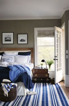 welcome guests with style: white linens, blue accents, texture, colored walls and a great rug.