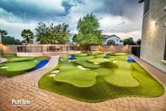 It's easy to maintain and all the custom features give it a visual appeal just like a rea… Golf Putting Green, Backyard Putting Green, Golf Green, Backyard Garden Design, Backyard Ideas, Backyard Sports, Indoor Outdoor, Outdoor Living, Jungle Resort