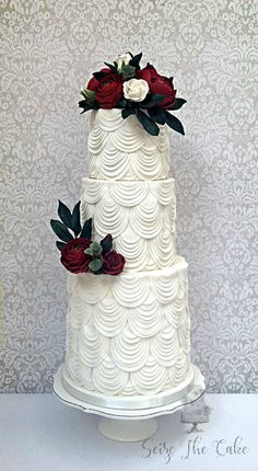 White drapes and red sugar flowers wedding cake by Seize The Cake